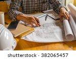 engineer working on blueprint... | Shutterstock . vector #382065457