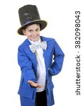 Small photo of Portrait of a funny little boy in mad hatter costume while saluting and bowing against isolated white background.