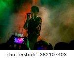 blurred singer in silhouette in ... | Shutterstock . vector #382107403