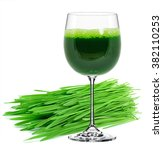 Small photo of wheatgrass juice in a glass isolated on a white background