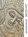 raised crafted buddha close up... | Shutterstock . vector #382251457