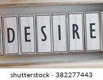 desire word on wood blocks... | Shutterstock . vector #382277443