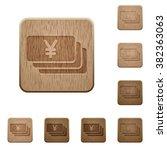 set of carved wooden yen...