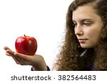 A Young Woman Holds An Apple I...
