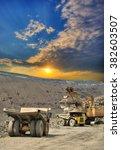 excavator loading iron ore into ...