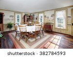 An Image Of A Dining Room In A...