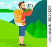 backpacker taking photo. | Shutterstock .eps vector #382804237