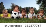happy boys with soccer ball  | Shutterstock . vector #382877767