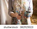 Small photo of Closeup of female artist hand holding paintbrush
