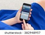 woman in a blue dress holding a ... | Shutterstock . vector #382948957