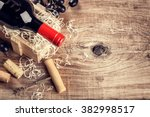 setting with bottle of red wine ... | Shutterstock . vector #382998517