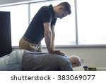 a chiropractor male exercising... | Shutterstock . vector #383069077