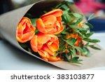 orange tulips packagedon a old... | Shutterstock . vector #383103877