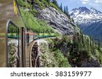 Small photo of White Pass & Yukon Route Railroad travels along the cliffs heading towards Skagway, Alaska