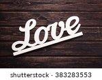 love inscription on a wooden... | Shutterstock . vector #383283553