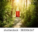 a red doorway is on a trail in... | Shutterstock . vector #383306167
