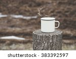 Old Mug With A Hot Drink On A...