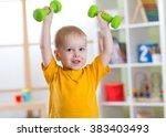 Smiling Little Boy Exercising...