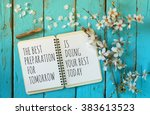 Open Notebook Over Wooden Tabl...