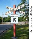 aging railroad crossing sign | Shutterstock . vector #383626