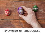 colorful easter egg in hand | Shutterstock . vector #383800663