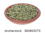 Small photo of A portion of damiana leaf in a small bowl isolated on a white background.
