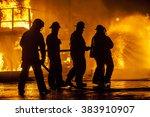 firefighters hosing down fire | Shutterstock . vector #383910907