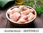chicken meat in wooden bowl | Shutterstock . vector #383950813