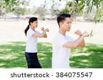 people practicing thai chi in... | Shutterstock . vector #384075547