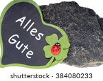 Small photo of Granite stone and heart sign with the german words all the best / All the best