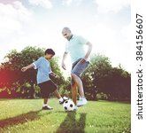 little boy playing soccer with... | Shutterstock . vector #384156607