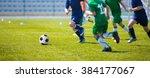 boys play soccer match. blue... | Shutterstock . vector #384177067
