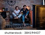 young couple watching tv at... | Shutterstock . vector #384194437