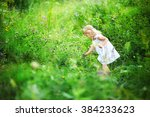 Beautiful Little Girl Picking...
