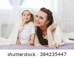portrait of a mother with her 9 ... | Shutterstock . vector #384235447