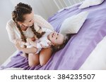 portrait of a mother with her 9 ... | Shutterstock . vector #384235507