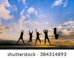 Silhouette Of Cheering Young...