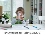little boy being creative... | Shutterstock . vector #384328273