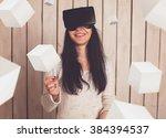 woman in virtual reality helmet.... | Shutterstock . vector #384394537
