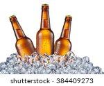 cold bottles of beer in the ice ... | Shutterstock . vector #384409273