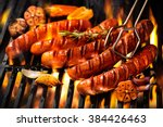 grilled sausage on the flaming... | Shutterstock . vector #384426463