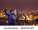 couple selfie at night city | Shutterstock . vector #384504187