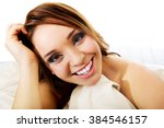 woman sitting on the bed... | Shutterstock . vector #384546157