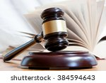 judicial hammer and the open... | Shutterstock . vector #384594643