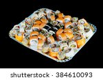 delicious sushi rolls  on black ... | Shutterstock . vector #384610093