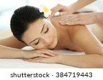 masseur doing massage on woman... | Shutterstock . vector #384719443