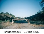 Small photo of Wooden roadblock in nature