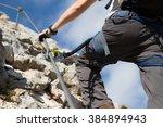man on via ferrata   close up | Shutterstock . vector #384894943