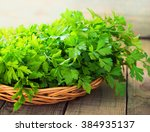 Fresh Green Parsley On Wooden...