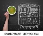 hands holding cup green tea on... | Shutterstock .eps vector #384951553